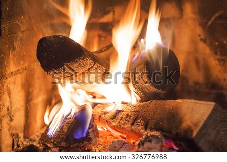 Firewood burning in fireplace fire flame heat red ashes
