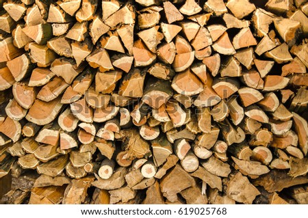 firewood. chopped logs stacked. background