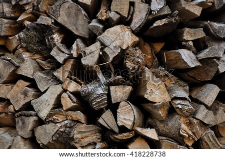 Firewood / Dry firewood in a pile for furnace kindling, wooden background - stock photo