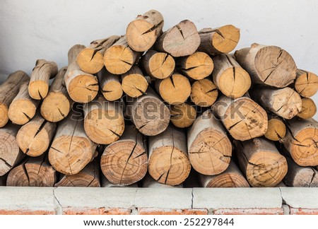 Firewood stack. Staple of biomass, arranged firewood. - stock photo