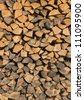 firewood stacked in a row one above the other - stock photo