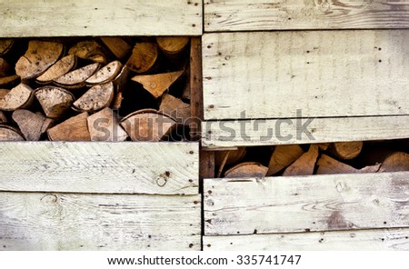 Firewood stacked in wooden hut