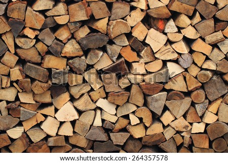 firewood texture as traditional wooden natural background - stock photo