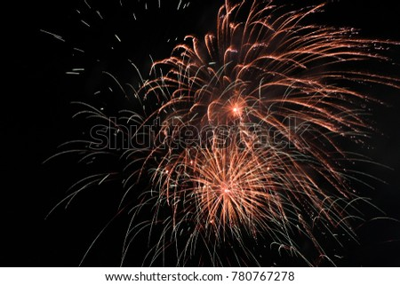 Firework blast in dark sky at night celebration new year,count down event,abstract lights explosion