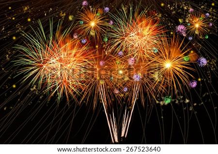 Firework celebration on dark background. - stock photo