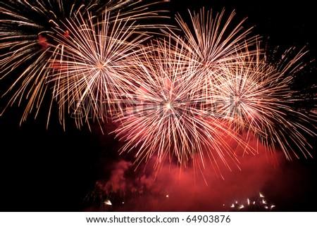 Firework exploding in night on black background. - stock photo