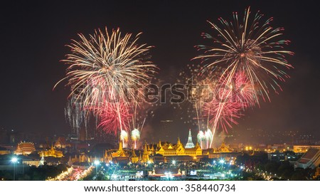 Firework show at Wat arun in 2016 count down in  Bangkok , Thailand with grand palace in the foreground.