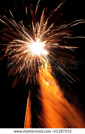 Firework streak in the black night sky - stock photo
