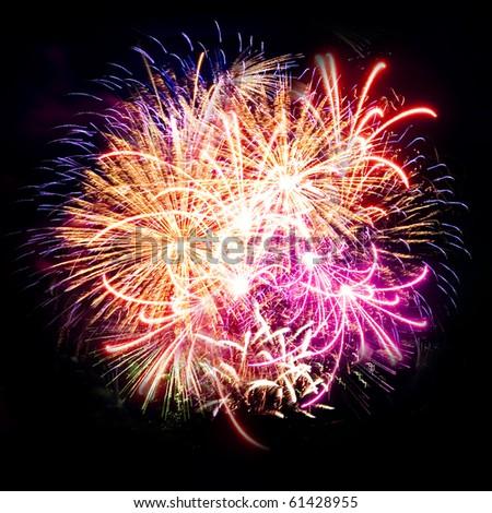 Firework streaks in night sky, celebration background - stock photo