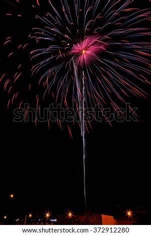 Firework streaks in the night sky - stock photo
