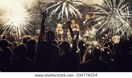 Fireworks and crowd celebrating the New year - stock photo