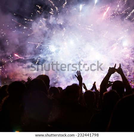 Fireworks and crowd waiting for New year - stock photo