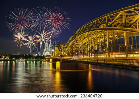 Fireworks at Cologne Cathedral and Hohenzollern Bridge, Cologne, Germany - stock photo