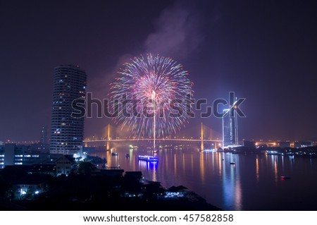 Fireworks at river and Bangkok, Thailand