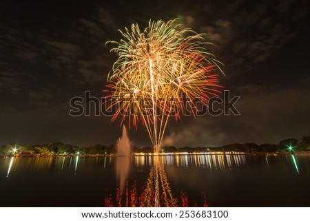 Fireworks at Suan Luang Rama IX in BBangkok,Thailand.People gathering here at to see firework and celebrate His Majesty the King's birthday. - stock photo