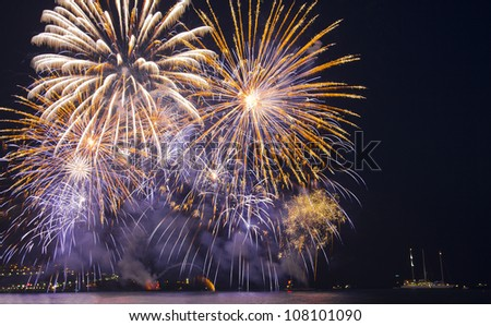 Fireworks at the beach - stock photo