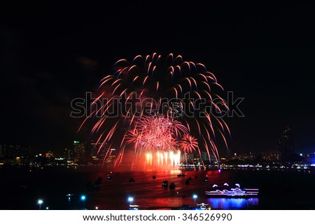 fireworks at the sea and city on background