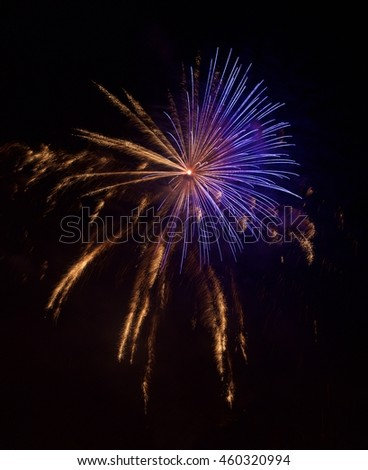 Fireworks. Blue orange red fireworks isolated in dark, New year, Christmas holidays, Independence day, explode, fragment photo of popular fireworks festival in Malta, Europe