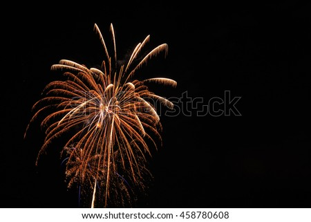 Fireworks burst in night sky with copy space. - stock photo