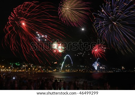Fireworks celebrating new year on the beach of Bombinhas in Brazil - stock photo