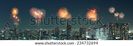 Fireworks celebrating over Tokyo cityscape at night, Japan (panorama) - stock photo