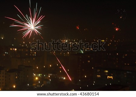 Fireworks celebration in the night city.