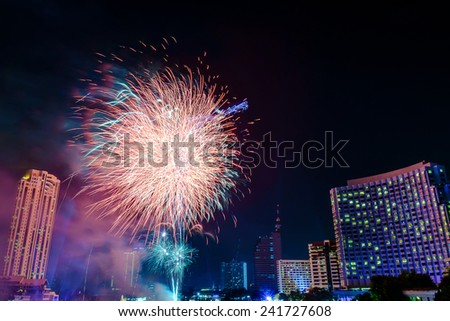 Fireworks countdown 2015 with fog and smoke over City view Bangkok Thailand.