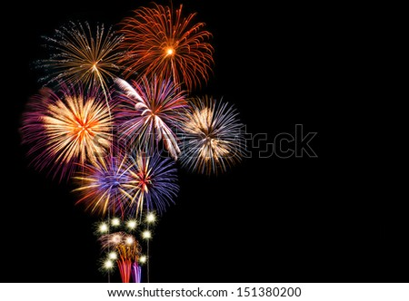 Fireworks display on a black background with copy space on right side. - stock photo