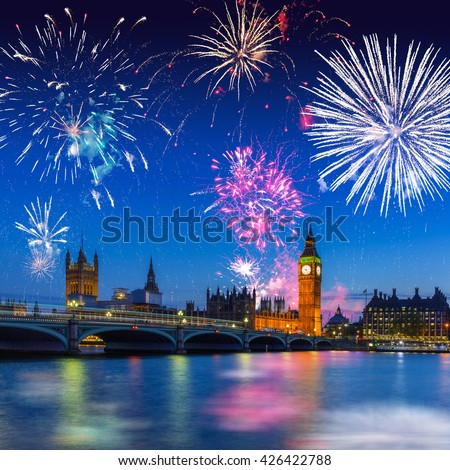 Fireworks display over the Big Ben and Westminster Bridge in London, UK - stock photo