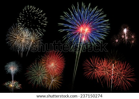 fireworks display sum Colorful fireworks on the black sky background  - stock photo