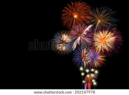 Fireworks display with copy space on the left side of image.  - stock photo