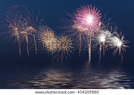 Fireworks, festive celebration light show at night, Works great and beautiful fireworks display, Flood water effects - stock photo