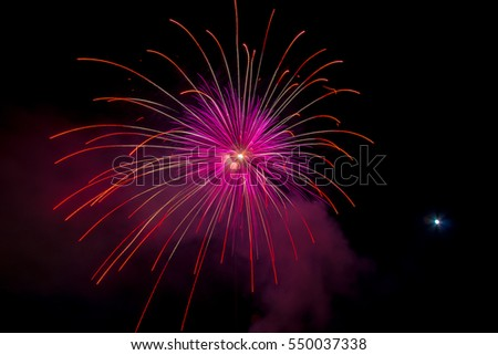 Fireworks in water on sea near Follonica, Italy