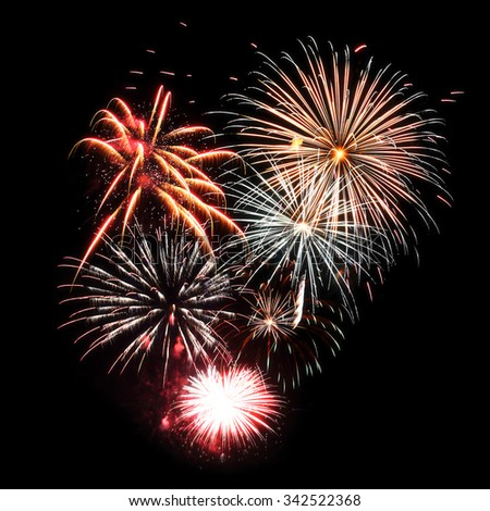Fireworks isolated on black. Colorful sparkles as new year background - stock photo