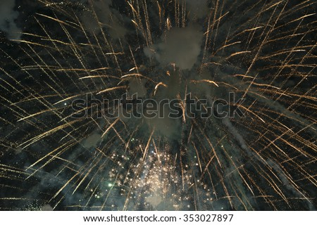Fireworks light up the sky black background