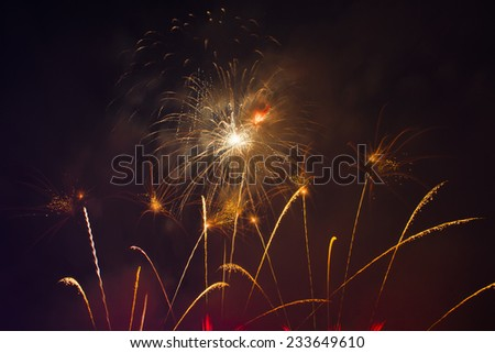 Fireworks light up the sky with dazzling display - stock photo