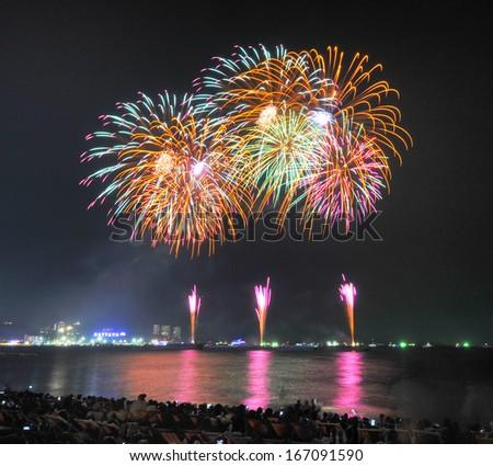 Fireworks new year celebration at Pattaya beach, Thailand  - stock photo