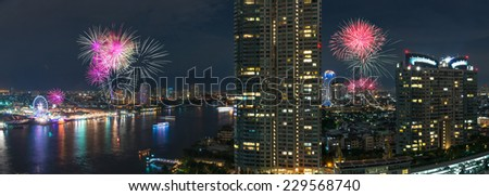Fireworks night scene with bangkok cityscape river view