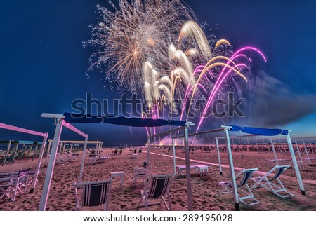 Fireworks on a beautiful beach. - stock photo