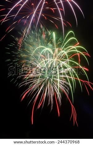 Fireworks on a black background - stock photo