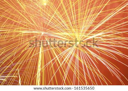 Fireworks on an orange background. - stock photo
