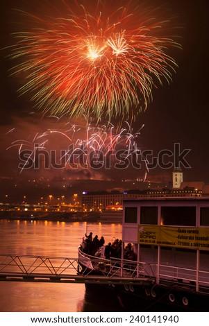 Fireworks on New Years Eve in Bratislava embankment, JAN 1, 2010 - stock photo