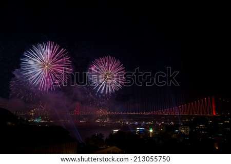 fireworks over bridge in Istanbul, Turkey - stock photo