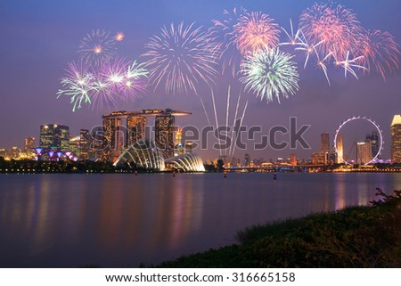 Fireworks over Marina bay in Singapore on national day fireworks celebration - stock photo