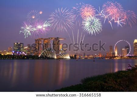 Fireworks over Marina bay in Singapore on national day fireworks celebration - stock photo