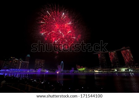Fireworks over Marina bay in Singapore on New Years Eve - stock photo