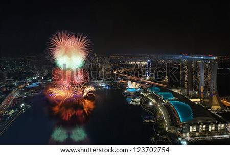 Fireworks over Marina Bay Singapore during New Year Celebration 2012 - stock photo