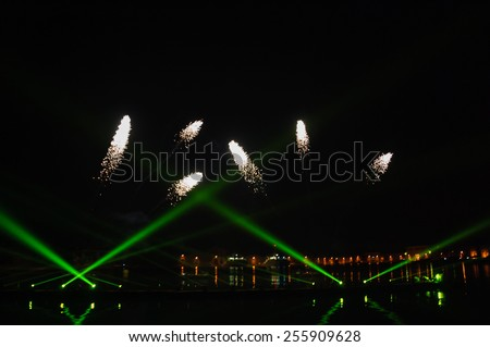 Fireworks over on the Arsenal lagoon during the Carnival celebration in Venice (Italy). Blurred lights. - stock photo