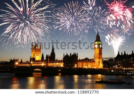 Fireworks over Palace of Westminster seen from South Bank - stock photo