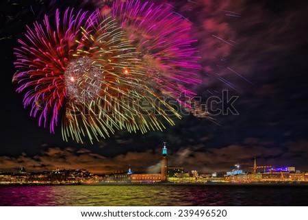 Fireworks over the town hall in Stockholm, clear sky with stars, Sweden  - stock photo